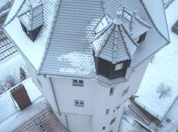 wir fotografieren das fertig sanierte Turmdach